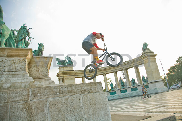 BMX cyclist doing stunt, Heroes' Square (Hosök Tere), Budapest, Hungary - CUF47793