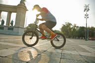 BMX cyclist doing stunt, Heroes' Square (Hosök Tere), Budapest, Hungary - CUF47796