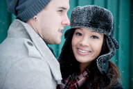 Young couple in winter hats, head and shoulder portrait - CUF47832