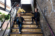 Boys talking on metal staircase - CUF47838