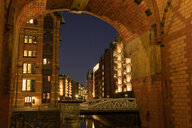 Germany, Hamburg, Speicherstadt, old warehouses at night - WIF03745