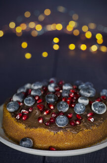 Homemade vegan blueberry cake with pomegranate seed and chocolate icing - JESF00204