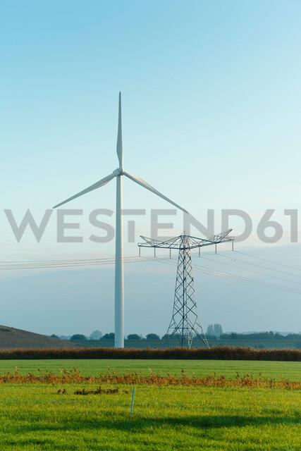 Field landscape with wind turbine and pylon in autumn, Netherlands - CUF47921