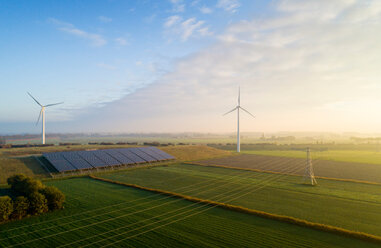 Field landscape with wind turbines and solar farm located on former waste dump, elevated view, Netherlands - CUF47924