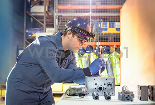 Engineer inspecting valves during outage in nuclear power station - CUF47963