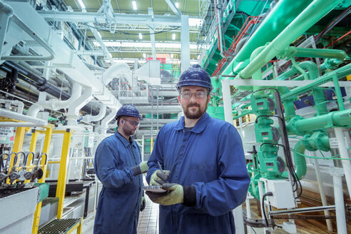 Portrait of engineer in turbine hall in nuclear power station - CUF47969