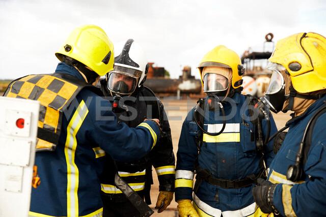 Firemen training, firemen in breathing apparatus listening to supervisor - CUF47978