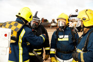 Firemen training, firemen in breathing apparatus listening to supervisor - CUF47978