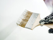 Man painting wall white - CUF48032
