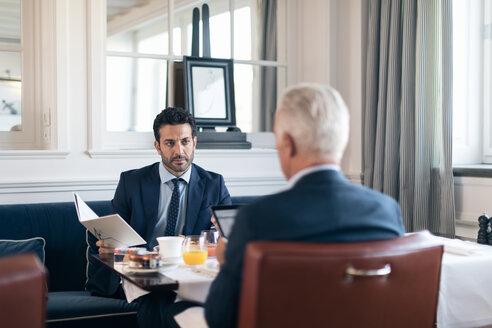 Businessmen talking in restaurant - CUF48068
