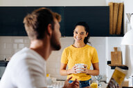 Young couple talking in kitchen - CUF48113