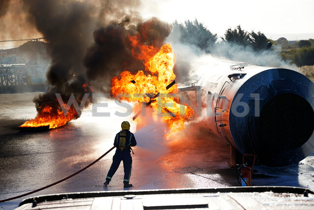 Firemen putting out fire on old training aeroplane, Darlington, UK - CUF48140