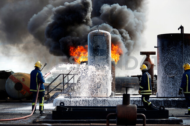 Firemen training to put out fire on burning tanks, Darlington, UK - CUF48146