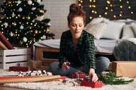 Woman wrapping Christmas presents - CUF48149