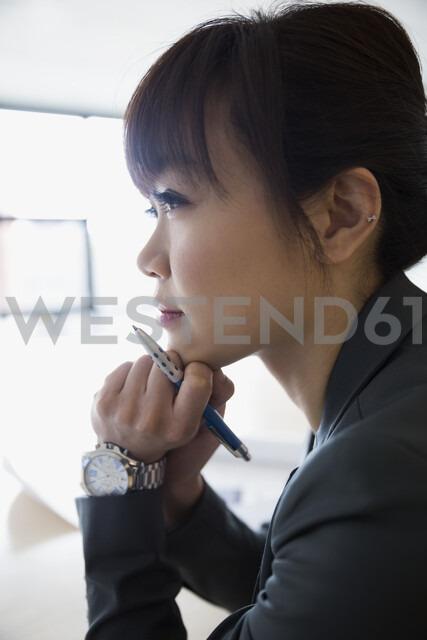 Close up portrait pensive businesswoman looking away - HEROF05235