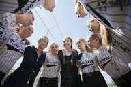 Coach and middle school girl softball team in huddle - HEROF05241