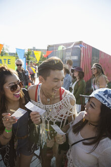 Enthusiastic young friends with summer music festival tickets - HEROF05274