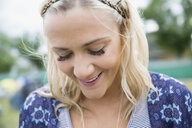 Close up portrait smiling young blonde woman looking down - HEROF05298