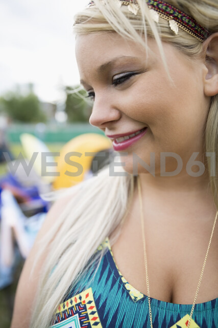 Close up portrait smiling young blonde woman looking down - HEROF05304