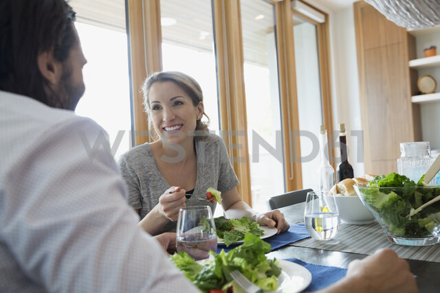 Couple eating salad at dining table - HEROF05346