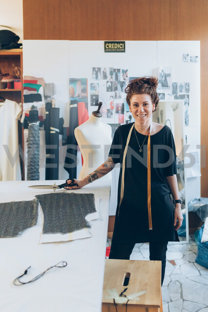 Portrait of fashion designer in her work studio - CUF48268