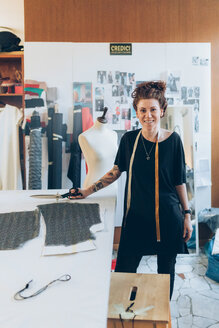 Portrait of fashion designer in her work studio - CUF48268