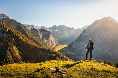 Hiker enjoying view, Karwendel region, Hinterriss, Tirol, Austria - CUF48301