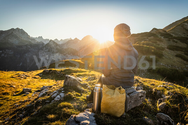 Hiker enjoying view, Karwendel region, Hinterriss, Tirol, Austria - CUF48304