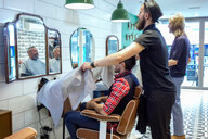Barbers working in barbershop - CUF48370