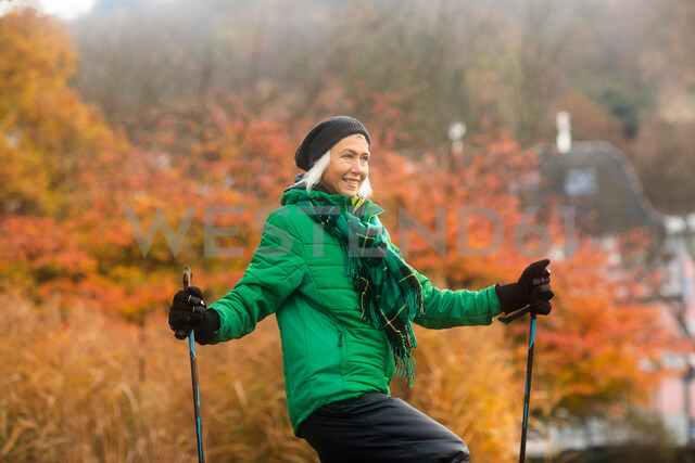 Mature woman nordic walking in park - CUF48373