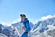 Man reading map, Mont Cervin, Matterhorn, Valais, Switzerland - CUF48394
