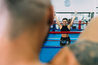 Male and female boxers working out in boxing ring - CUF48397