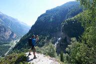 Hiker taking photograph, Mont Cervin, Matterhorn, Valais, Switzerland - CUF48439