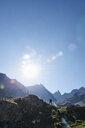 Hiker going up to peak of rock, Mont Cervin, Matterhorn, Valais, Switzerland - CUF48442