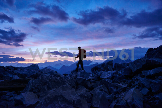Hiker at dusk, Mont Cervin, Matterhorn, Valais, Switzerland - CUF48445