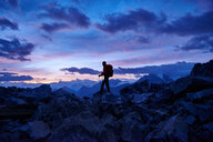 Hiker at dusk, Mont Cervin, Matterhorn, Valais, Switzerland - CUF48445