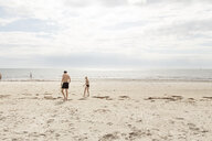 Man and girl walking on a beach in Osterlen, Sweden - FOLF10264