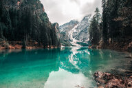 Landscape with turquoise lake and snow capped mountains, Dolomites, Italy - ISF20205