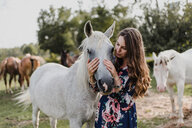 Woman hugging horse - ISF20241