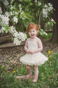 Toddler in tutu by blossom tree - ISF20253