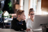 Siblings using computer at home - ISF20289
