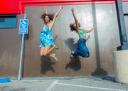 Friends jumping for joy in car park - ISF20292