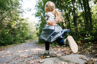 Little girl running in forest - ISF20310