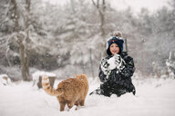 Boy tempted to throw snowball at cat - ISF20331