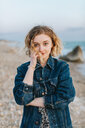 Blond haired young woman on beach, portrait, Menemsha, Martha's Vineyard, Massachusetts, USA - ISF20340