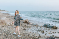 Young woman strolling on beach, portrait, Menemsha, Martha's Vineyard, Massachusetts, USA - ISF20343