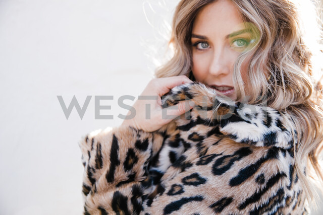 Fashionable woman in leopard print coat - ISF20382