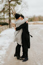 Couple hugging in snowy landscape, Georgetown, Canada - ISF20490