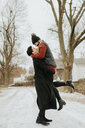 Happy couple enjoying snowy landscape, Georgetown, Canada - ISF20496