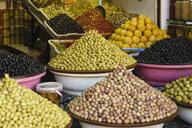 Abundant variety of fresh olives on display in souk market stall, Marrakesh, Morocco - FSIF03706